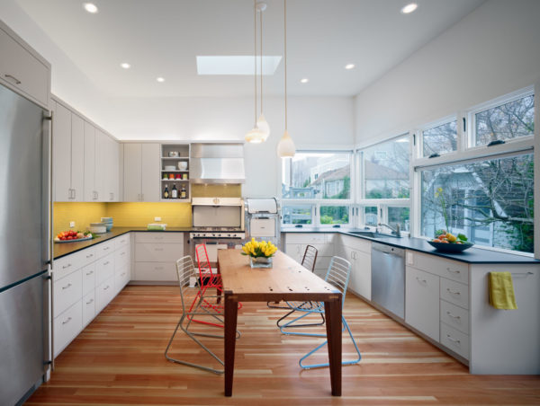 eat-in kitchen with blue cabinet and yellow ceramic backsplash for modern color balance of warm and cold shades