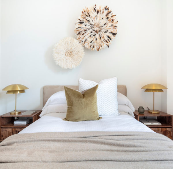 gold pillow and light fixtures with white walls for a contemporary bedroom