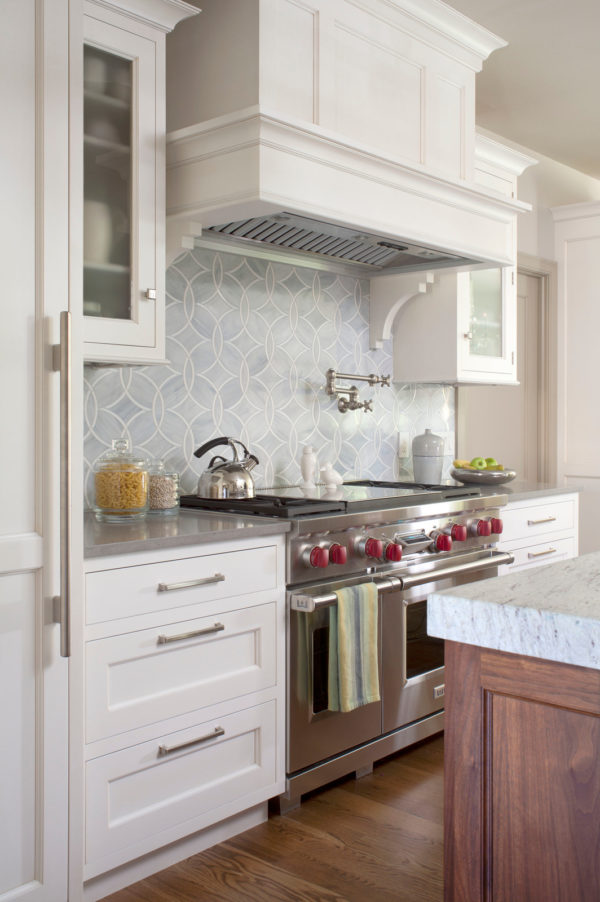 this classic bright farmhouse uses stainless appliances to complement white cabinets