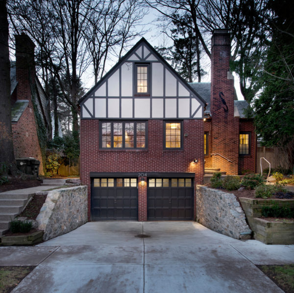 embellish your red brick house with black color slate roofs, copper flashings, and timber assemblies