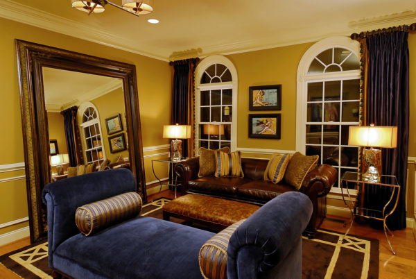 choose benjamin moore mystic gold hc-37 walls and blue fabric upholstery for a masculine living room