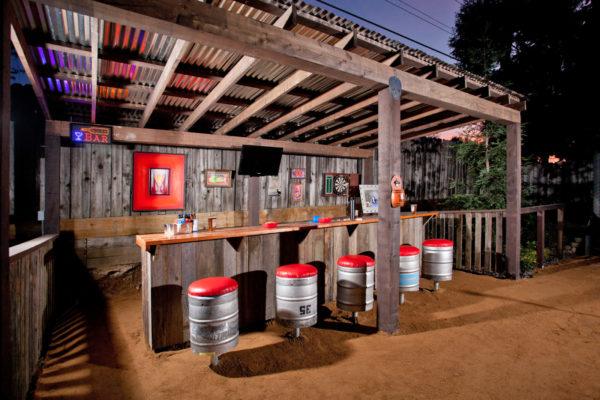corrugated metal pergola for a mountain-style patio with retro decor and cedar structure