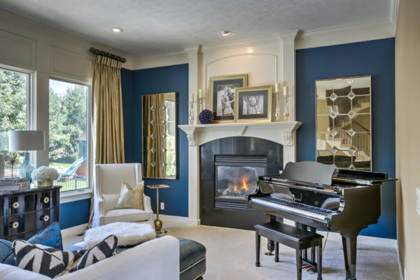 evoke contemporary elegance in your living room with sherwin williams rainstorm sw6230 blue walls and gold ornaments