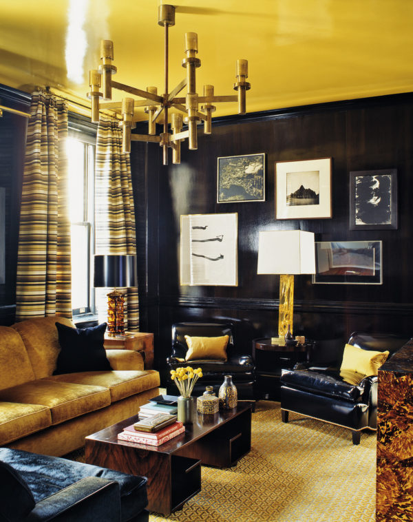 play with gold ceilings and dramatic chandelier with dark blue upholstery for dark royalty vibes