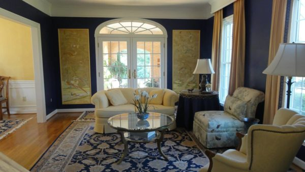 try hanging gold curtains and waverly home classics paintings on beautiful blue living room walls