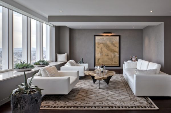 achieve a luxurious ambiance with dark gray walls, white sofas, and antique rug