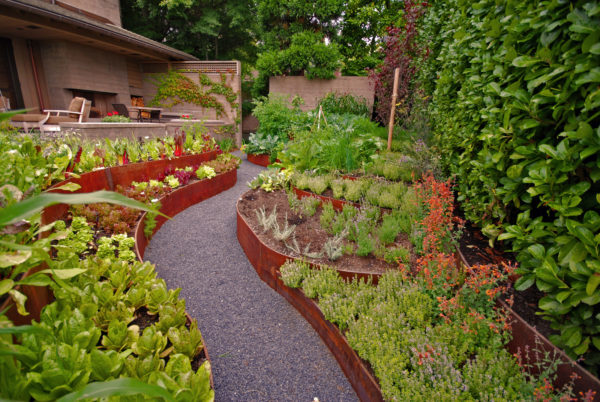 build a green thumb's paradise with some retaining walls made from corten steel planters