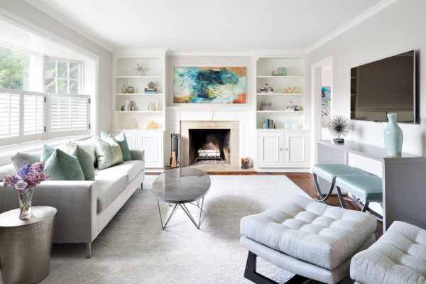 clean and cozy white living room with built-in shelves and warm grey furniture