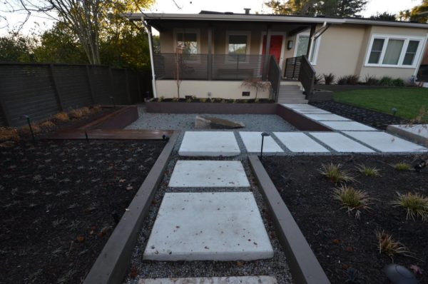 consider a clean modern front yard with corten steel retaining wall and open play areas