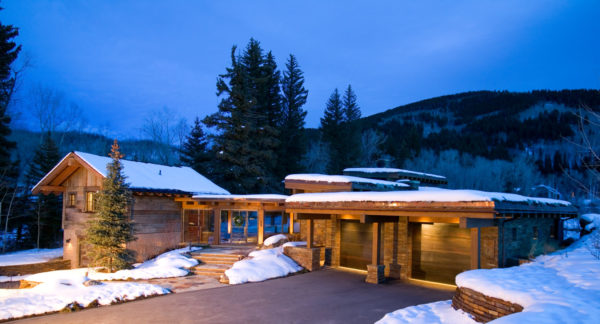 cozy breezeway design and detached garage for a more rustic feel in this mountain house
