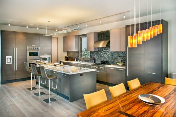 create a bright and modern kitchen with grey-stained oak cabinets and stainless-steel appliances