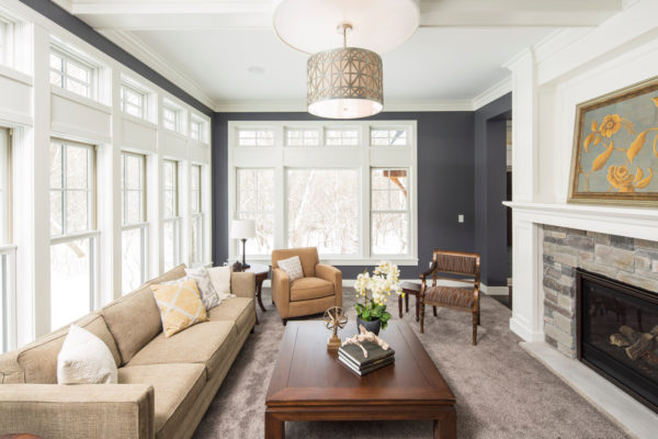 create an exquisite living room featuring gray and white walls and massive floor-to-ceiling windows