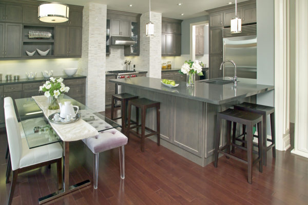 go for a contemporary charm with grey-stained kitchen cabinets and stunning glass dining table