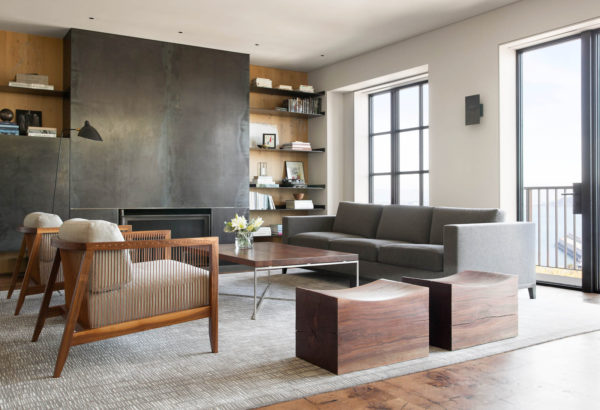 go for a contemporary formal living room using white walls, grey carpeting, and wood furniture