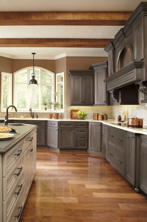 install colorful backsplash behind grey-stained kitchen cabinets for a beautiful traditional vibe