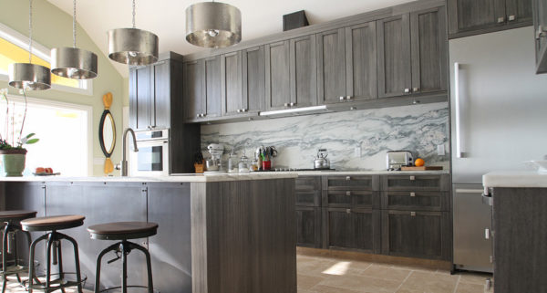 install unique light fixtures to elevate the grey-stained kitchen cabinets in your contemporary home