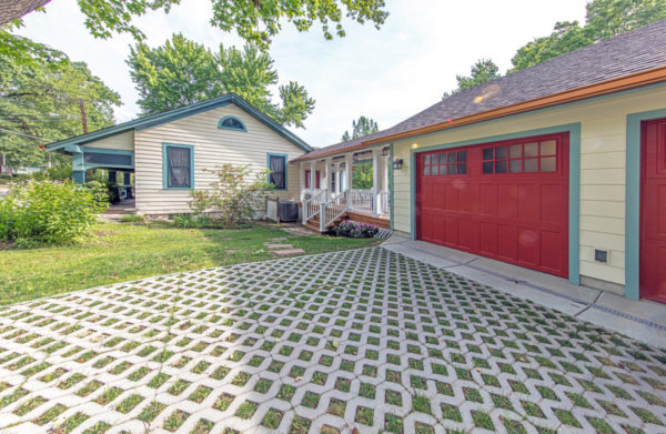 play with bold colors to create an eclectic craftsman house, complete with a detached garage and breezeway