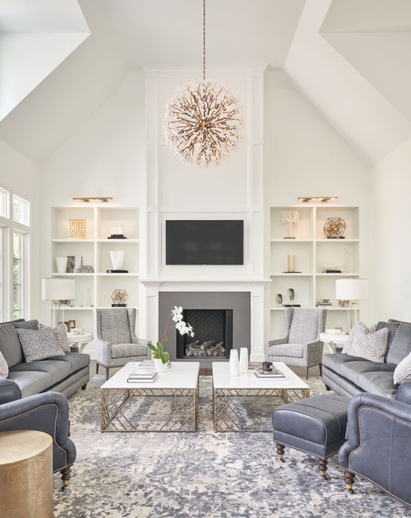 play with textures for a floral-inspired white and gray living room with cozy carpet and beautiful pendant lamp