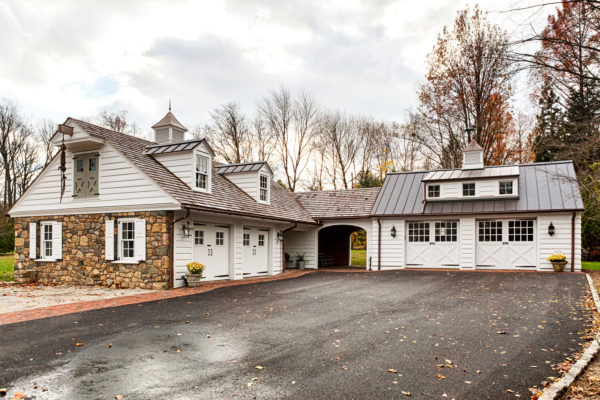 try a classic farmhouse style with this stunning detached garage idea and private breezeway