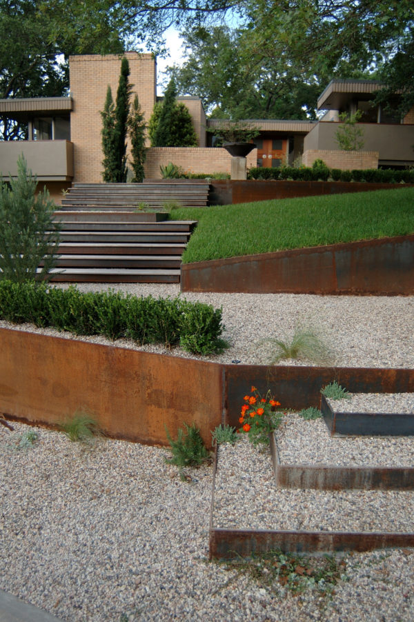 try a contemporary corten steel retaining wall landscape with dynamic step design and gravel