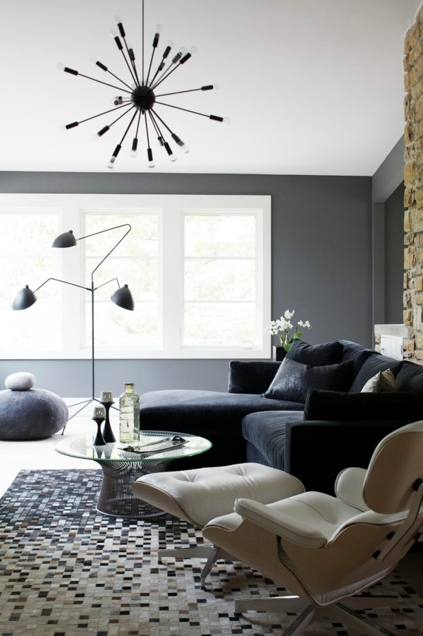 try a stainless-steel chandelier to decorate a modern white and gray living room with mid-century roots