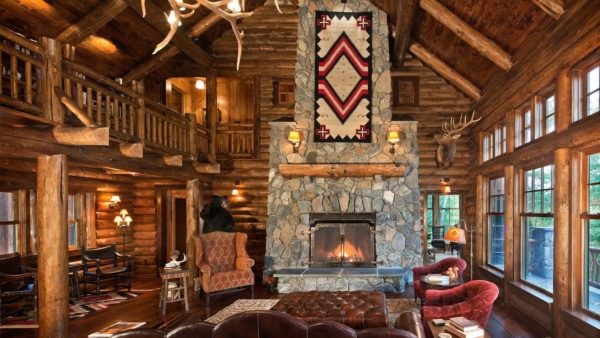 a huge two-level log cabin living room with lots of decorative pieces and art
