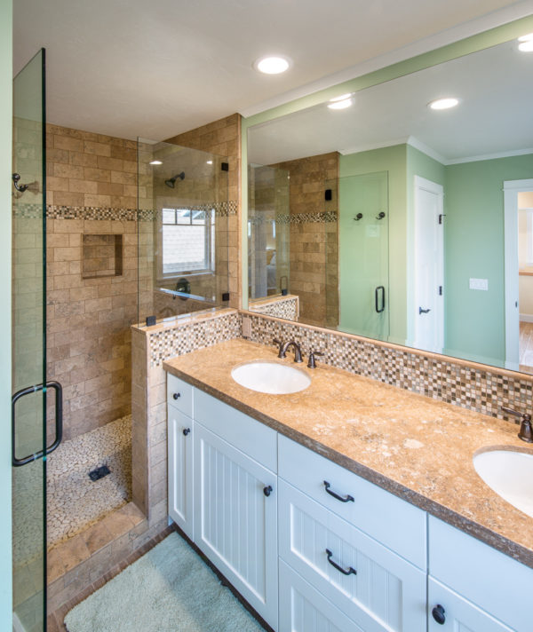 build a bright beach style master bathroom with brown tiles and beautiful green walls