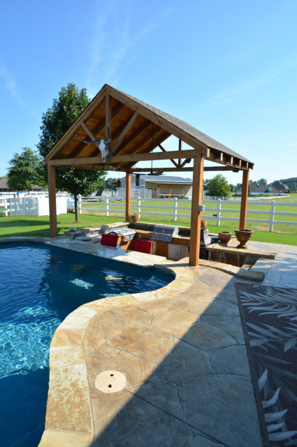 combine countryside and rustic charm with stamped concrete pool deck and cozy hot tub