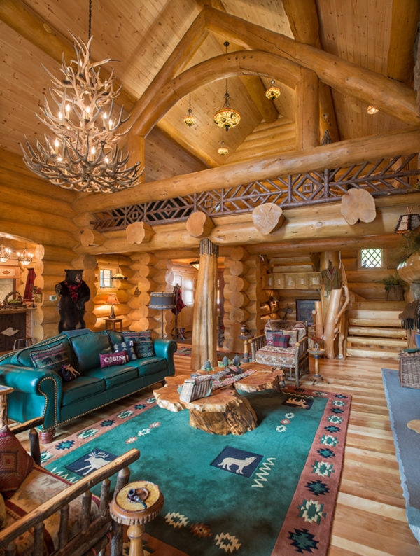 elevate your log cabin living room with printed rug and green leather couch