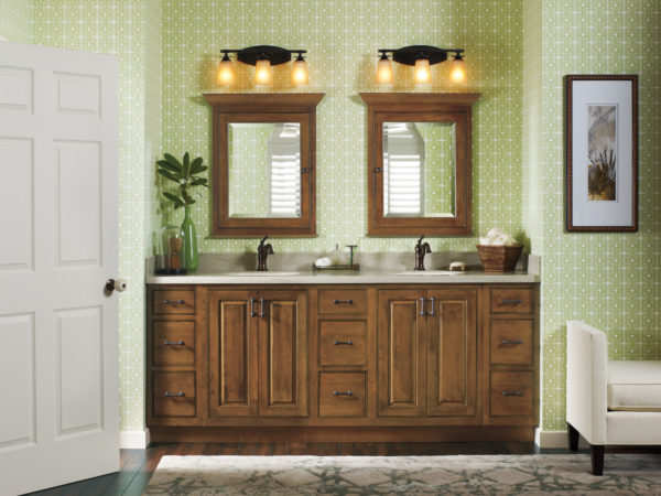 install brown cabinetry to complete this gorgeous bathroom with patterned green walls
