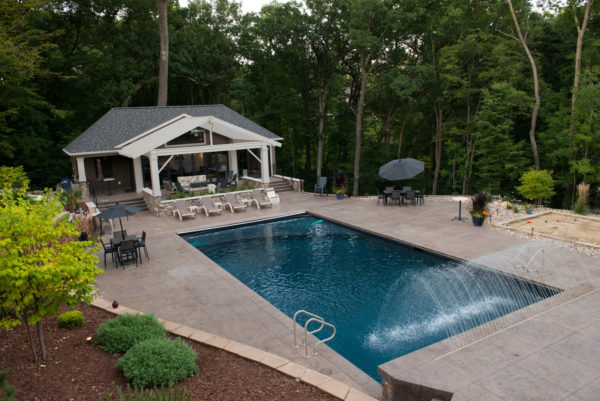 make your backyard fancy with stunning water feature and stamped concrete jumping deck