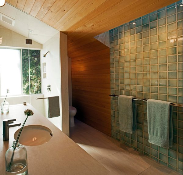 maximize a slanted bathroom with alcove shower by mixing green and brown walls