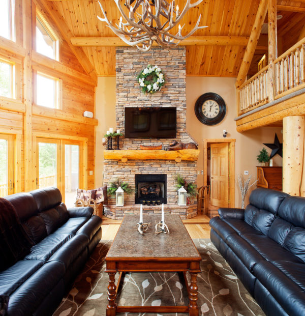 maximize natural light to enhance the light wood elements in this modern log cabin living room