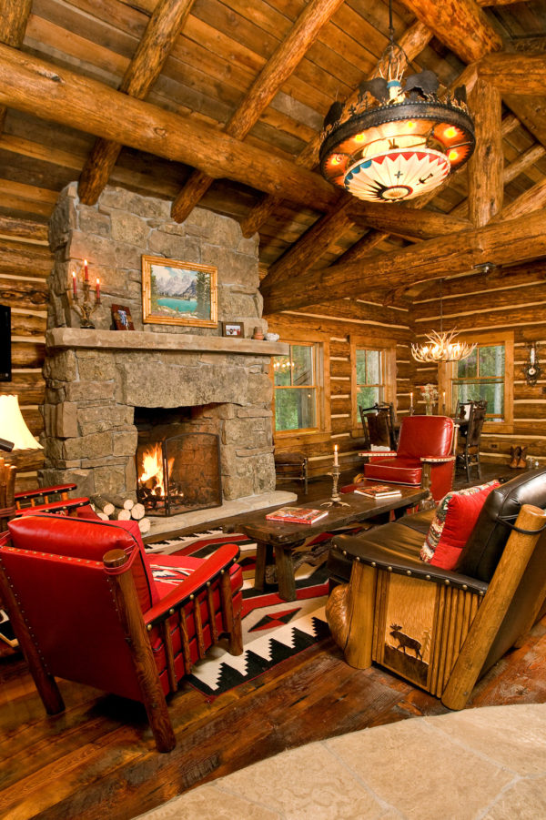 mix red leather with natural wood in log cabin living room tones for a rustic feel