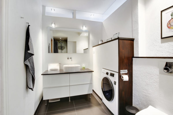 mix wood and white walls for an elegant bathroom and laundry room combo
