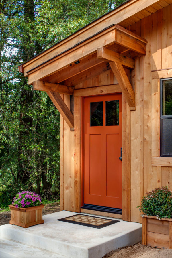 opt for all wood in this classic barn style entry with a slanted roof over the front door