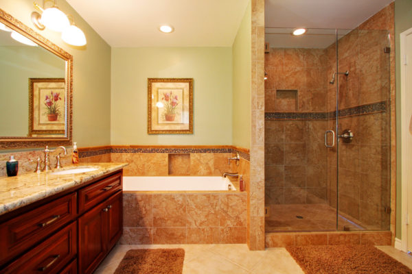 pair alcove shower with brown ceramic tiles and green walls to induce traditional charm