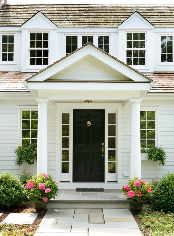 traditional roof over door entry with tuscan columns for a strong suburban curb appeal