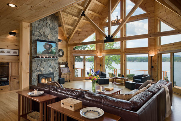 try a scenery-centred log cabin living room using light toned wood flooring and walls