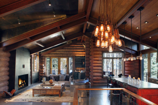 try an open concept log cabin living room connected with the family dining area