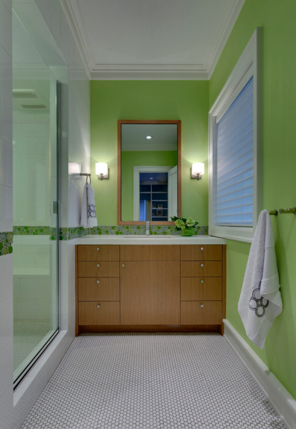 try using light green walls to complement light brown cabinet for a modern bathroom