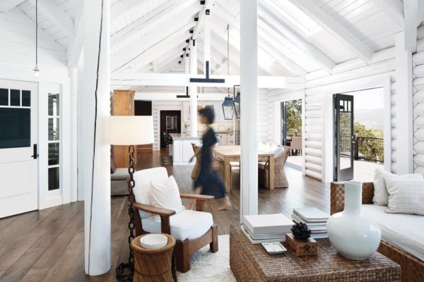 use white log and wood furniture for a modern and bright cabin living room