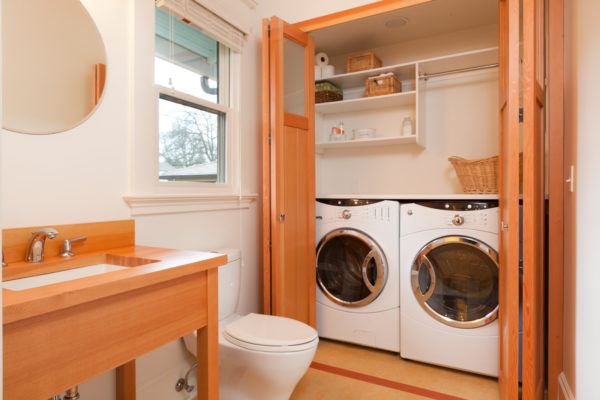 use wooden bifold doors to hide washer dryer for a stylish bathroom laundry combo