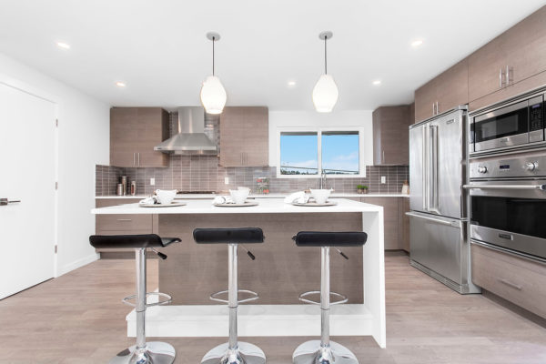 choose a trendy kitchen remodel featuring brown medium toned wood flooring and classic white walls