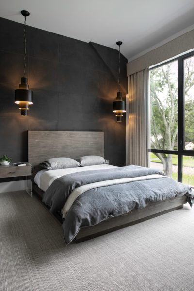 encapsulate contemporary elegance in the bedroom with black walls and grey carpet flooring