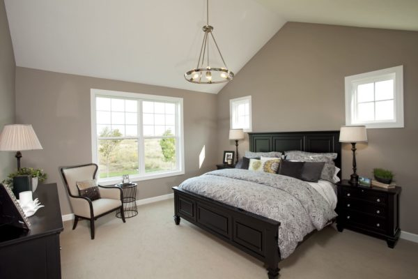go for traditional bedroom charms through ornate black furniture and patterned grey sheets