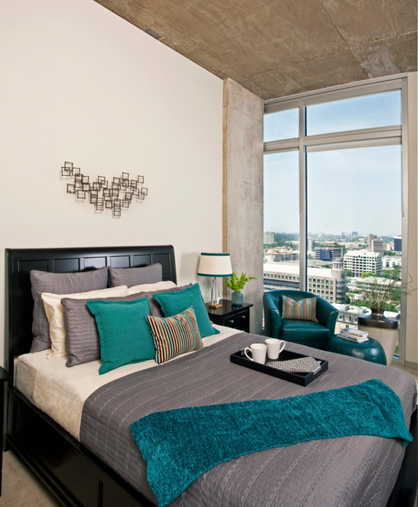jazz up a black and grey bedroom with colorful accents and wall art