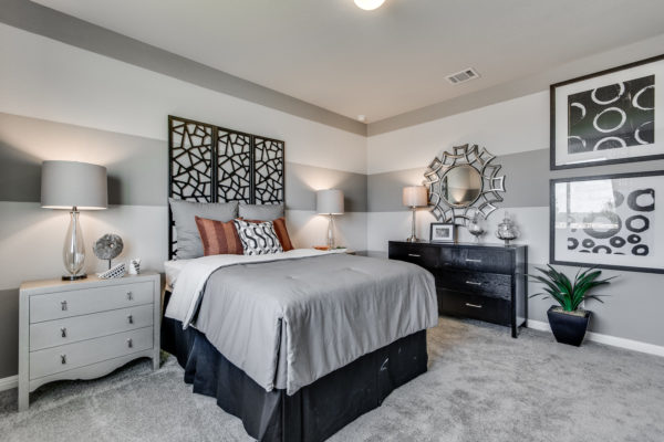 mix all shades of grey and black art installations to create an eclectic and expressive bedroom