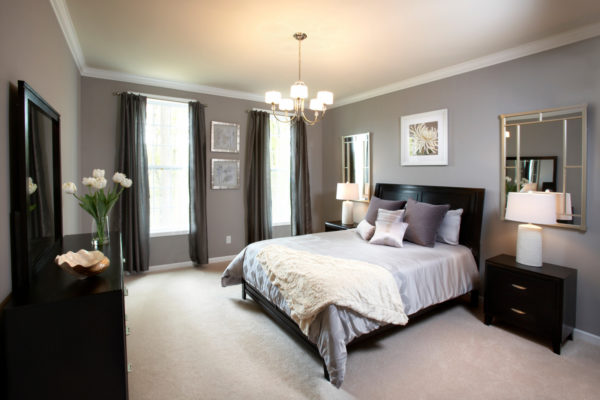 pair warm grey colors and black furnishing with deep brown tones for a comfy bedroom