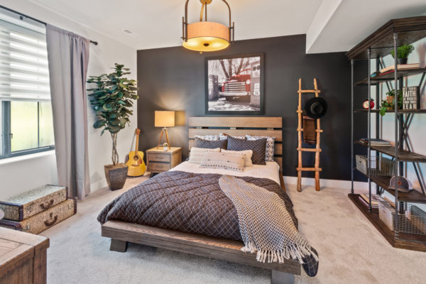 play with wood textures and personal mementos for a playful black and grey bedroom